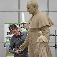 Fagan sculpting Pope JPII